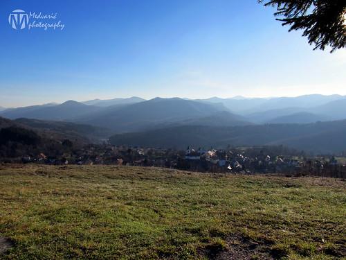 winter sky mountain mountains grass landscape village hills valley