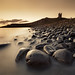 Dunstanburgh Castle by Alistair Bennett
