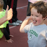 hmc012 -- Mason McCreery gets a high-5 after finishing the Kids Fun Run.