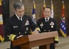 Adm. Harry B. Harris Jr., signs a guest book prior to an office call with Adm. Choi Yoon-hee, right, chairman of the Republic of Korea's Joint Chiefs of Staff, in Seoul Nov. 21. (U.S. Navy Photo by Mass Communication Specialist 1st Class Joshua Bryce Bruns)