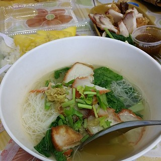 Yummy noodles, crispy pork and mango glutinous rice dessert at chatuchak