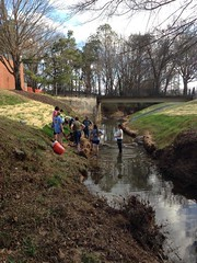 Students take part in a live staking workshop on the campus' own Parkerson Mill Creek. The students will apply the process in their work on sections of the Clearfork River as part of their spring break trip in Tennessee.