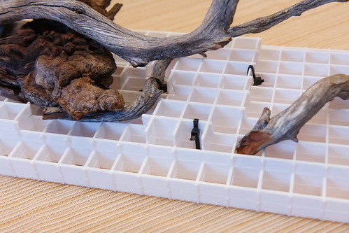 zip ties securing aquarium driftwood to light egg crate panels