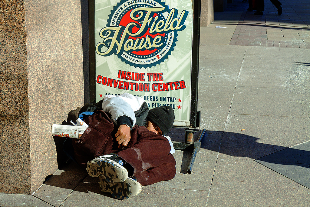 Man-lying-in-front-of-Field-House-sign-on-1-28-15--Center-City