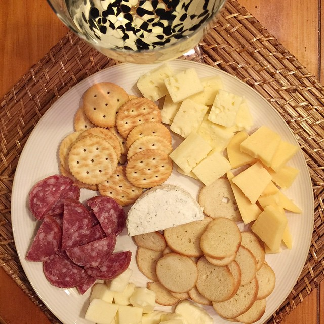 My favorite kinda dinner... I call it the 'picnic' dinner. All kinds of different cheeses, bagel chips and crackers and a red wine sausage... The wine is a Camelot mead honey wine from a local winery, so refreshing! Just what I needed tonight with the hub