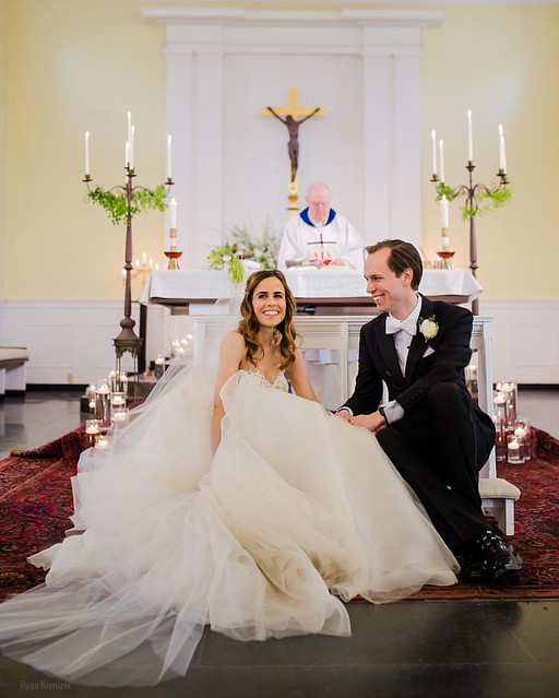 During Communion, Jen and Jonathan turned around and sat on the kneeler so they could look at all their guests. I had never seen this before in hundreds of Catholic ceremonies, and it was extremely adorable.  (And lest anyone think they were treating this