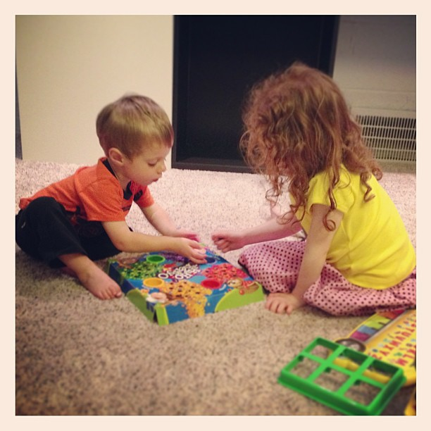 Happily playing a game together in their new playroom.  #renovation