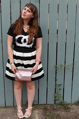 """Black and white striped bubble skirt """"Scalloped Stripes Ponte Skirt"""" by Girls from Savoy for Anthropologie, Zevs dripping Chanel logo t-shirt, pink satin ballet flats with ankle ties, carved rose bangle, rose gold Marc Jacobs for Target pouch"""