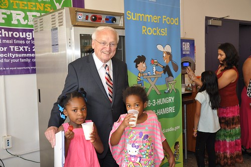FNCS Under Secretary Kevin Concannon poses with kids drinking low-fat milk.