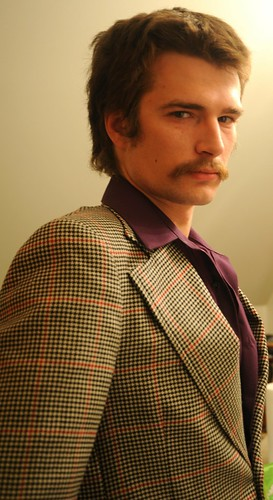 Groomsman Adam Fisher dressed in vintage 1970's garments, mustache, purple shirt, Jessie and Chris's wedding, Tail Waggin' Lane, Fairbanks, Alaska, USA by Wonderlane