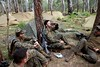 US marines enjoy a brief rest during military training by ABC News
