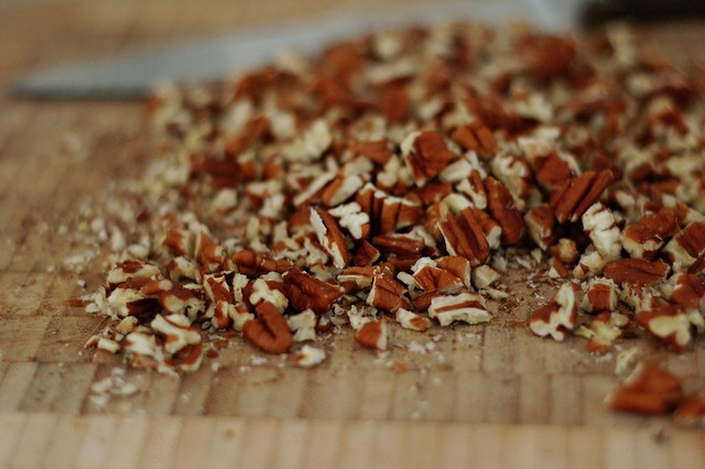Chopping pecans for the oatmeal chocolate chip pecan cookies by Eve Fox, the Garden of Eating, copyright 2015