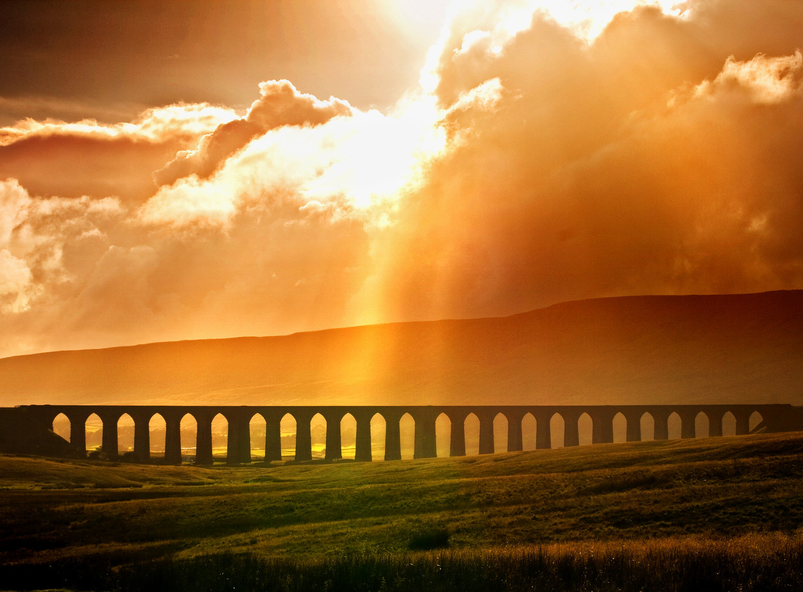 Ribblehead Viaduct cast in a glowing light. Credit chantrybee