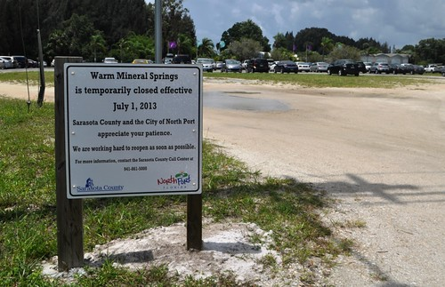 A sign indicating Warm Mineral Springs is closed effective July 1, 2013, stands at the entrance. North Port, Fla., June 30, 2013