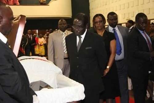 Republic of Zimbabwe President Robert Mugabe and First Lady Grace Amai viewing the body of ZANU-PF veteran Enos Nkala on August 29, 2013. by Pan-African News Wire File Photos