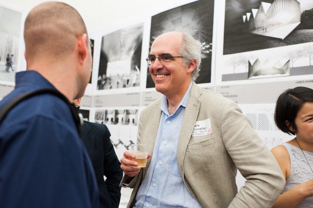 Mark Cruvellier talks with guests after the lecture.