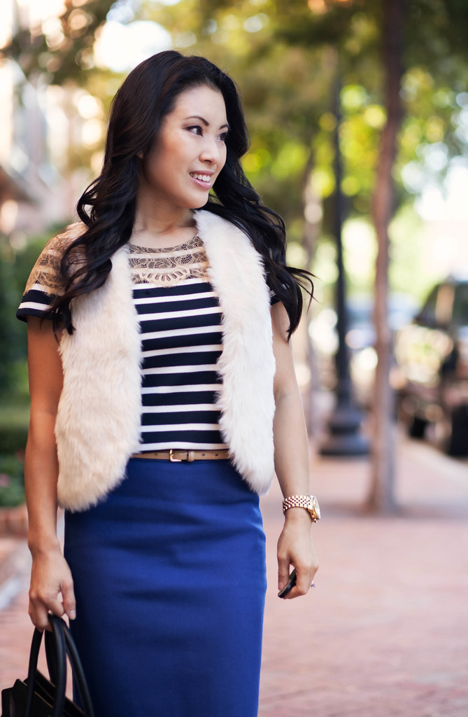 cute & little blog | white fur vest, nautical striped lace top, j. crew blue pencil skirt, sole society tierra black gold cap toe, celine mini luggage tote outfit #ootd
