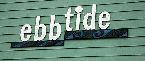 "ebb tide, sign, waves, similar to TIbetan symbol for ""Everyone in existence now here this!"", siding, Anchorage, Alaska, USA by Wonderlane"