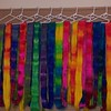 Hand dyed Merino roving hanging up to dry. Brilliant! #perchance2knit #handdyed #merinowool #rainbows