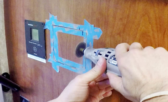 Wed, 06/22/2016 - 21:45 - Using a Dremel cutting tool to make the hole in the cabinet for the solar remote panel