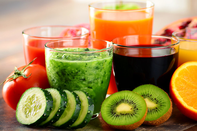 Glasses of fresh organic vegetable and fruit juices