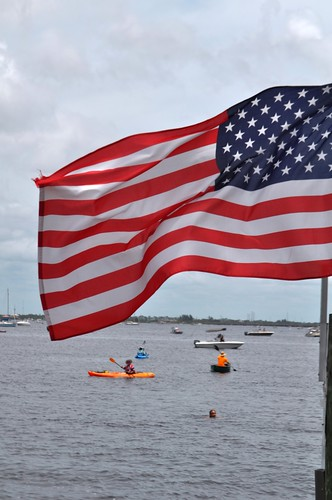 Swimmers Make their Way to Harpoon Harry's at Fishermens' Village, Punta Gorda, Fla, July 4, 2013