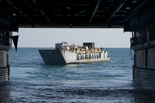 A landing craft utility (LCU), assigned to Naval Beach Unit (NBU) 7, disembarks the well deck of  USS Denver.