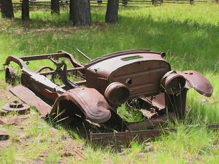 Old car chassis  in field (202)