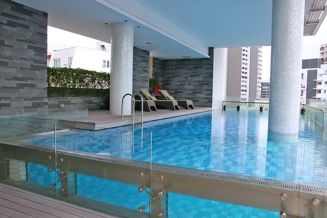 The glass-encased infinity pool is high up on the 12th floor