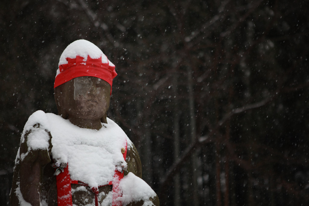 Jizo Statue Bracing Against A Blizzard, Tokyo