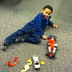 Issac playing with cars.