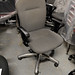 Grey fabric swivel chair