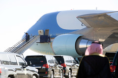President Obama and First Lady Michelle Obama disembark from Air Force One after flying from New Delhi, India, to King Khaled International Airport in Riyadh, Saudi Arabia, on January 27, 2015, so they, U.S. Secretary of State John Kerry and other dignitaries could extend condolences to the late King Abdullah and call upon and meet with the new King Salman. [State Department photo/ Public Domain]