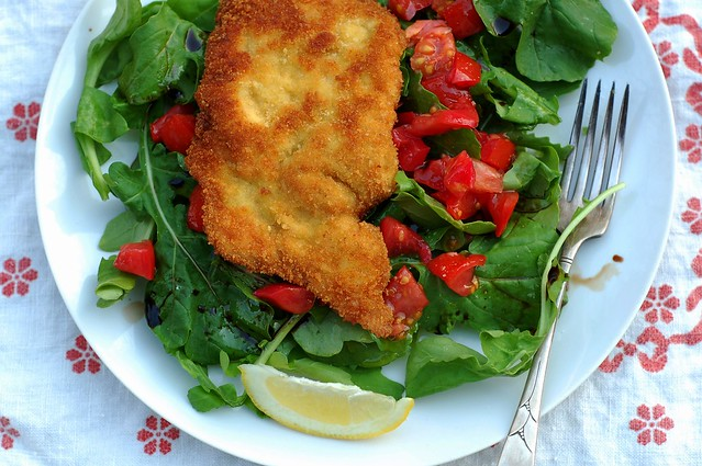 Chicken Milanese over a bed of fresh arugula with tomato by Eve Fox, Garden of Eating blog, copyright 2012