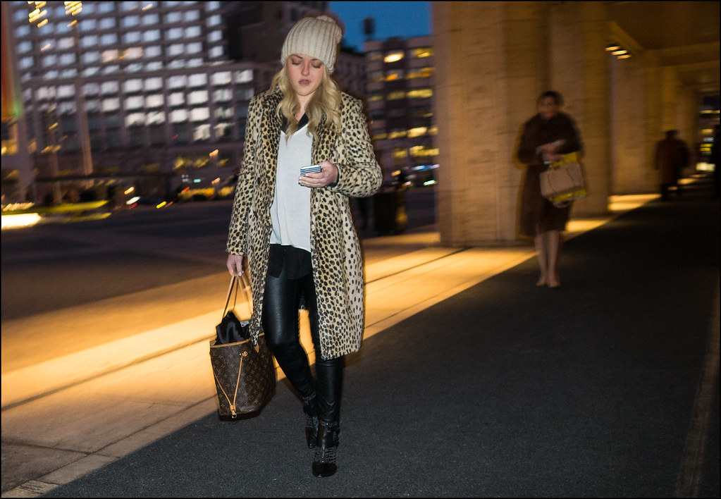 FW2-15  21w Long leopard print coat over white shirt black leggings knit cap Louis Vuitton bag ankle boots