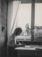 Little girl writing at her desk