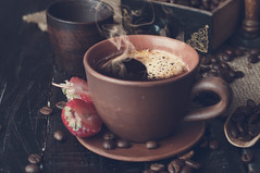 Coffee cup and saucer on a wooden table. Tonned ph…
