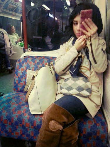 Applying make-up in the London Underground