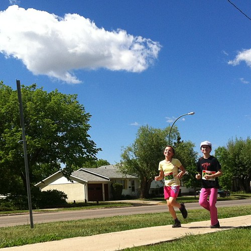 Kaylie and her friend J, about halfway through their 5k race
