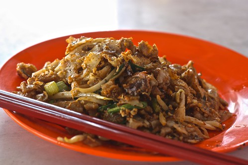 char kway teow… wide noodles with egg, pork, and shrimp. And vegetables…