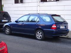 compact car(0.0), sedan(0.0), honda civic(0.0), automobile(1.0), automotive exterior(1.0), vehicle(1.0), honda(1.0), land vehicle(1.0),