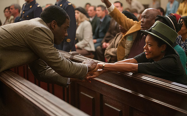 Idris Elba and Naomie Harris keep it together in MANDELA: LONG WALK TO FREEDOM.