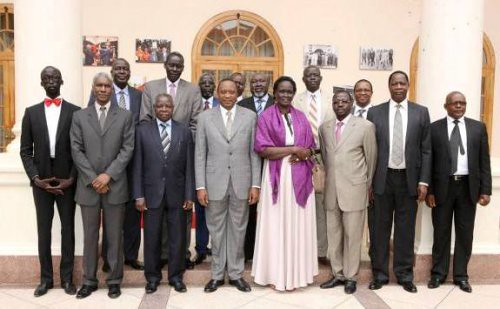 Kenyan President Uhuru Kenyatta, center, with seven released opposition leaders and Rebecca Garang. The delegation is participating in peace talks in Ethiopia. by Pan-African News Wire File Photos