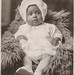 Small photo of African American baby wearing a bonnet