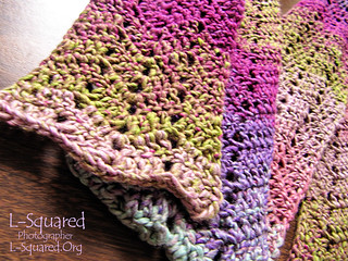 Chevron Scarf - a scarf worked in a zig-zag pattern with yarn that gradually fades from dusty rose, light blue, violet, magenta and moss green.