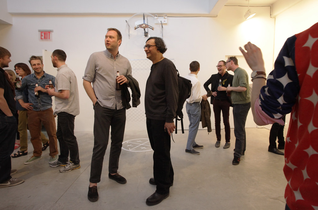 Department of art chair and associate professor Iftikhar Dadi, center, with Graham MacDougal.