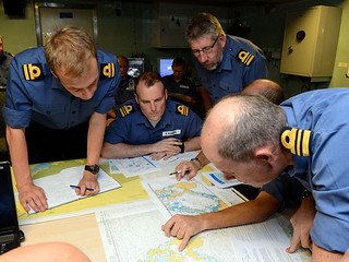 Officers consult charts of Phiilipines
