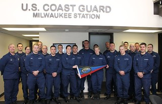 Capt. Matthew Sibley (left), commander of Coast Guard Sector Lake Michigan, poses with crew members from Coast Guard Station Milwaukee after presenting the unit with the Sumner I. Kimball Award for Excellence, Jan. 31, 2014. The Kimball Award recognizes Coast Guard small boat stations that demonstrate excellence in operational readiness and vessel condition. U.S. Coast Guard photo by Lt. Brian Dykens