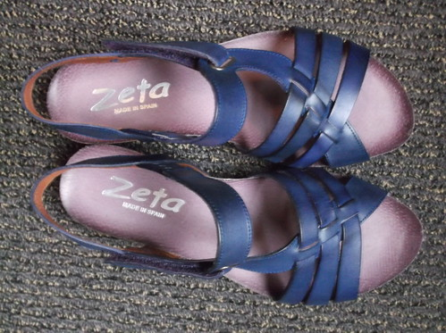 Blue sandals, purple soles