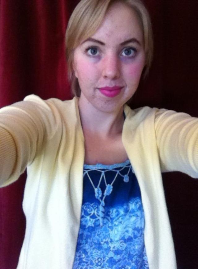 selfie in yellow cardigan, blue lace-print dress